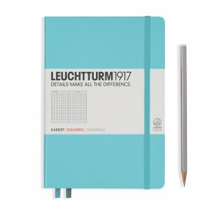 notebook-medium-a5-hardcover-249-numbered-pages-squared-light-blue