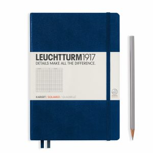 notebook-medium-a5-hardcover-249-numbered-pages-squared-navy