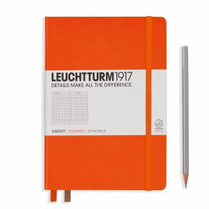 notebook-medium-a5-hardcover-249-numbered-pages-squared-orange