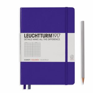 notebook-medium-a5-hardcover-249-numbered-pages-squared-purple