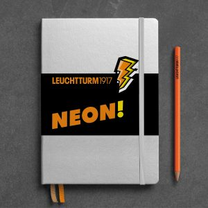 notebook-medium-a5-hardcover-251-numbered-pages-silver-neon-orange-dotted